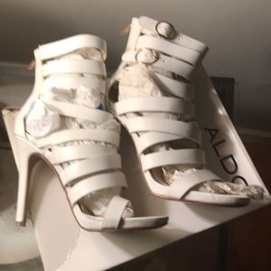 White strappy heeled sandals by Aldo size 7.5